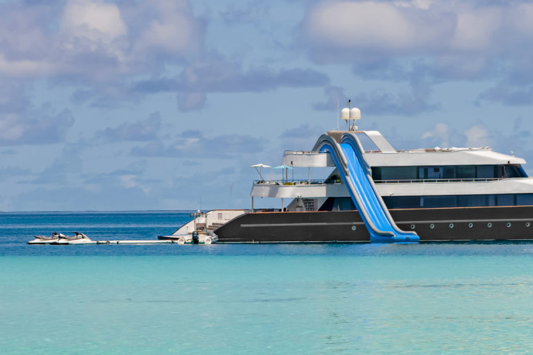 yachting boat with water slide, maldives islands.